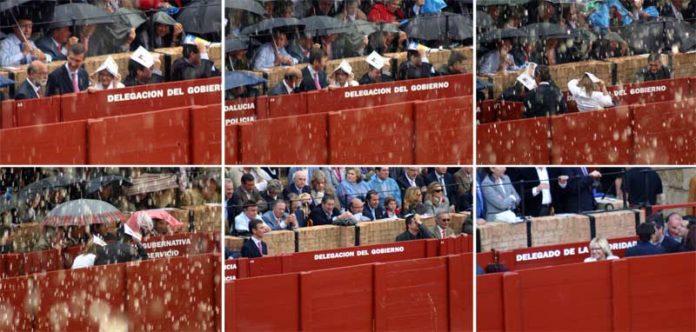 La delegada Carmen Tovar, de blanco, abandona el burladero y recorre el callejón durante la lidia del quinto toro, para regresar cuando la lluvia cesa. (SECUENCIA: Javier Martínez)